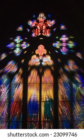 Seeing the light and peace concept with light shafts coming through stunning stain glass Church Window as Christ holds out his hands with a Dove underneath