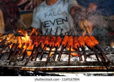 Seekh Kebabs, camel kebabs street food in Indian Ramadan market in Shivaji Nagar Bengaluru. Muslim big food festival Iftar party.