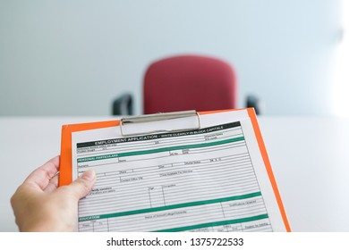 Seeking job concept, filling up the information in an employment application form