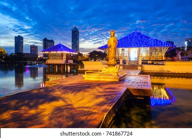 Seema Malaka buddhist temple in the Beira Lake in Colombo, Sri Lanka at sunset. Seema Malaka is a part of the Gangaramaya Temple.