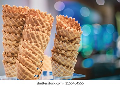 Seemingly endless towers of waffle cones in uneven rows.