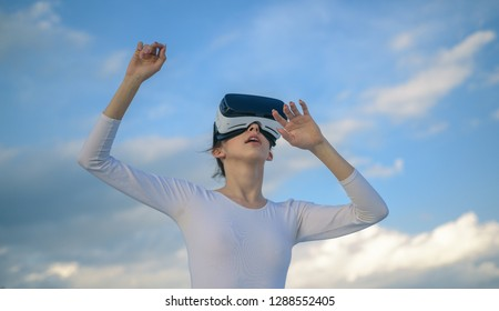 It seems so real. Cute girl play in simulated environment. Young woman gesturing in vr glasses. Pretty girl wear virtual reality headset. Innovative vr technology. Virtual technology simulation.