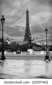 Seen from the Alexander iii Bridge. early morning view on eiffel tower with beautiful clouds, in black and white, in sky, and business man walking out of the image
