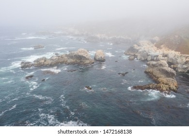 Seen from a bird's eye view, the Pacific Ocean washes against the rocky coast south of Monterey in Northern California. This beautiful area runs parallel to the famed Pacific Coast Highway.
