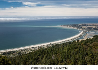 Seen from hiking trails in the hills, the gentle curve of Stinson Beach, just north of San Francisco, California, stretches northward on a sunny day.