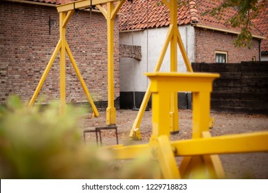 Seesaw, swing and sandbox for children to play. Old nostalgic playground in heritage musuem