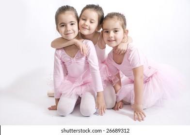 seet friends.Little ballerina girl hug her friends