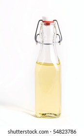 See-trough bottle with oil.