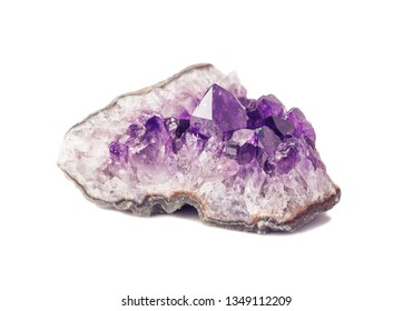 Segment of Amethyst gemstone geodes from Uruguay isolated on a white background
