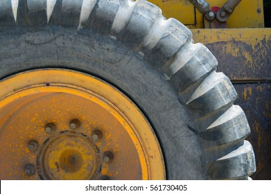 Segment of large tire on road grader