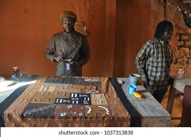 Segou, Mali - December, 27, 2014: Local people and tourists working in Segou