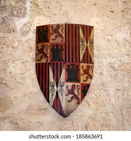 SEGOVIA, SPAIN - APR 5, 2014: Shield inside the Alcazar of Segovia (Segovia Castle), a stone fortification, Segovia, Spain. It's one of the inspirations for Walt Disney's Cinderella Castle.