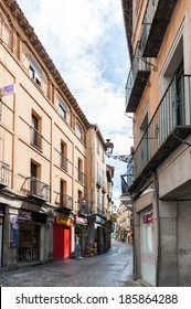 SEGOVIA, SPAIN - APR 5, 2014: Unidentified people walk in the Old Town of Segovia, Spain. Old Town of Segovia is the UNESCO World Heritage