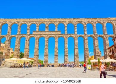 Segovia, Spain- June 07, 2017: Aqueduct of Segovia (or more precisely, the aqueduct bridge) is a Roman aqueduct in Segovia. Segovia  were declared World Heritage Sites by UNESCO.