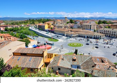 SEGOVIA, SPAIN - JUNE 2 - 2013: Aerial view of old city in Castile and Leon declared World Heritage Sites by UNESCO. People at Plaza Artilleria, shops, restaurants, bars
