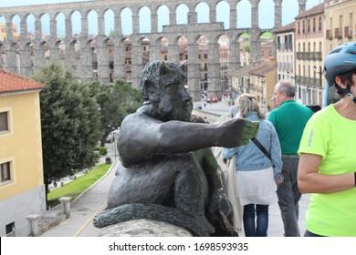 Segovia, Spain, May 2019: imp of Sogodeus next to the Aqueduct