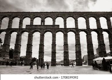 SEGOVIA, SPAIN - MAY 22, 2019: Ancient Roman aqueduct closeup view in Segovia
