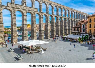 SEGOVIA, SPAIN, OCTOBER 4, 2017: People are walking towards famous aqueduct at Segovia, Spain