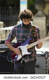 SEGOVIA, SPAIN - SEPTEMBER 20, 2014: A young band, calling themselves Zarigueyas, playing in the main square free for anyone who wants to listen.