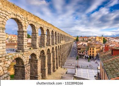 Segovia, Spain town skyline at the ancient Roman aqueduct.