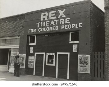 Segregated movie theater for African Americans in Leland, Mississippi, Nov. 1939. 'Rex Theatre for Colored People' advertised the official film of Joe Louis-Bob Paster fight. Photo by Dorothea Lange.