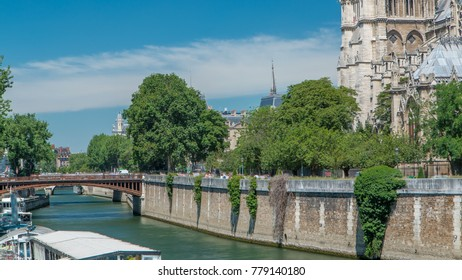 Seine with Double Bridge and Notre Dame de Paris is the one of the most famous symbols of Paris. View from Bridge of the Archbishopric with boat station at sunny summer day