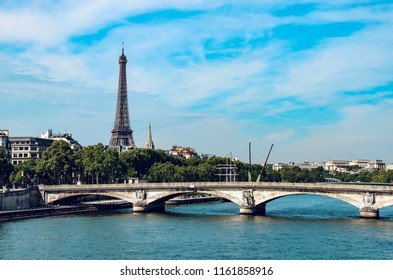 Seine and Eiffel Tower with Pont des Invalides in Paris, France