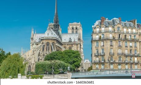 Seine and Notre Dame de Paris timelapse is the one of the most famous symbols of Paris. Saint-Louis bridge. View from embankment at sunny summer day