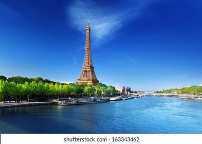 Seine in Paris with Eiffel tower in sunrise time