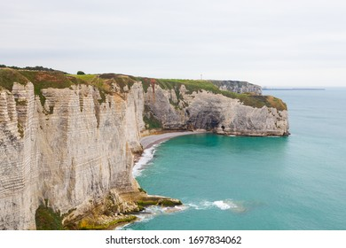 Étretat, Seine-Maritime / France - OCTOBER 14, 2018: Étretat is best known for its chalk cliffs, which include natural arches, monolithic formations, and its rocky beach.