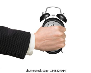 Seizing the time and present opportunities concept. Businessman hand grasping alarm clock, isolated on white background.