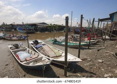 sekinchan,selangor-11th july 2017;A shot of colorful chinese fishing boat resting at a Chinese Fishing Village- Sekinchan, Malaysia