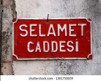 Selamet Caddesi (Salvation Avenue) sign in Cunda Island, Ayvalik, Turkey.