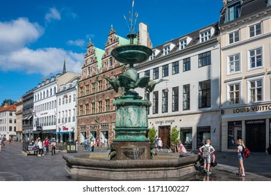 Selandia, Denmark - august 04, 2018: Commercial street of Stroget, with the Stork fountain and medieval buildings in the historic center of the city of Copenhagen