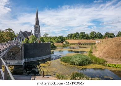 Selandia, Denmark - august 04, 2018: Gardens and canals of the Castellet and Saint Albans church in the historic center of the city of Copenhagen