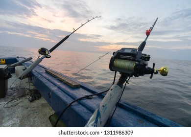 Selangor- January 26 2019:Unidentified anglers fishing on the boat during sunset time.