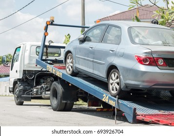 Selangor, Malaysia - 07 August, 2017: A car has broken down and being pulled up into the tow truck.