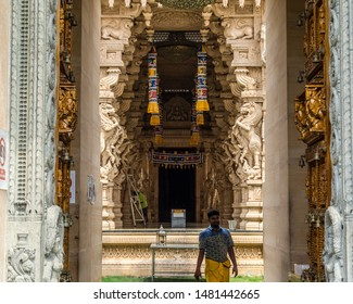 Selangor, Malaysia 08/07/2019. Sri Shakti Devasthanam Temple is one of the most beautiful hindu temples in Malaysia. A young hindu man is walking out after his prayer.