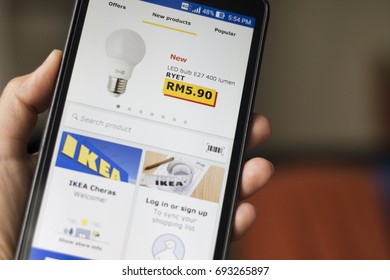 Selangor, Malaysia - 09 August, 2017: Phone user browsing IKEA catalogue on smartphone. IKEA is one of the world's largest furniture retailer.