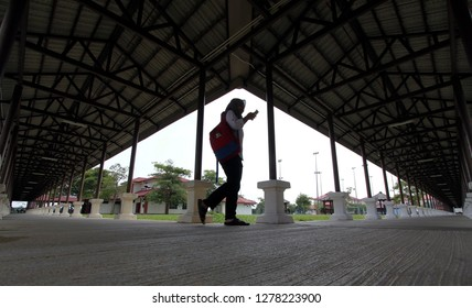 Selangor, Malaysia - 09 January 2019: A woman walk along a covered walkway in the district at the Banting, Selangor, Malaysia.