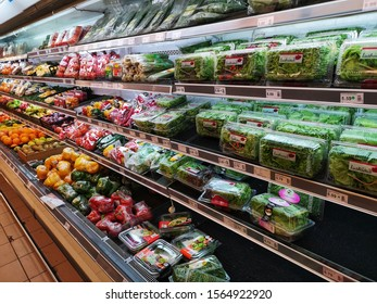 Selangor, Malaysia - 13 November 2019 : Vegetables packed inside plastic container and plastic wrap. Displayed on the cool chiller rack inside the supermarket with selective focus.
