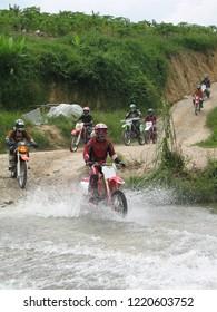 Selangor, Malaysia 2 Nov : Adventure  bikers crossing river during weekend motocross ride in Kemensah.