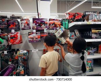 Selangor, Malaysia - 8 October 2017 : Brother and sister checking out the toys at Tesco Bandar Puteri, Putra Mahkota, Bangi.