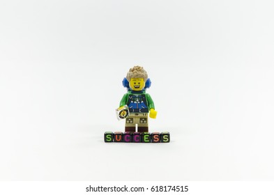 selangor, malaysia. APRIL 03, 2017, lego hiker miniature with word success. This mini figure is from Collectable series 16.Lego minifigures are manufactured by The Lego Group.