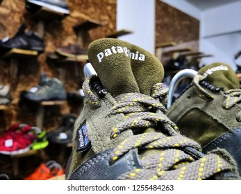 Selangor, Malaysia- April 2018 : Closeup on outdoor shoes of Patagonia brand on shelf display in the  shop for sale. Selective focus.
