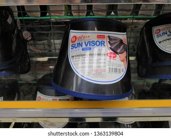 Selangor, Malaysia- April 2019 : Sun visor display for sale at Daiso shop, Ecurve shopping mall. Daiso Industries Co., Ltd. is a large franchise of 100-yen shops founded in Japan.