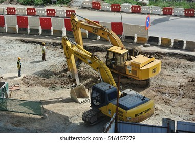 SELANGOR, MALAYSIA -AUGUST 08, 2016: Excavators machine is heavy construction machine used excavate soil at the construction. Powered by long hydraulic arm with bucket. Operate by workers
