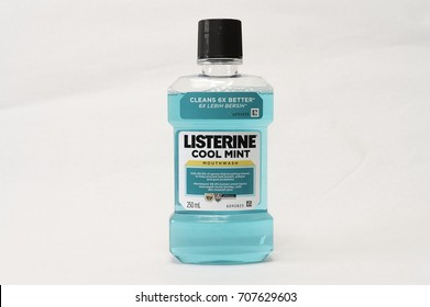 Selangor, Malaysia - August 13th, 2017: Listerine Cool Mint Mouthwash kills 99.9% of germs that brushing misses to help prevent bad breath, plaque and gum problems. Isolated on white background.