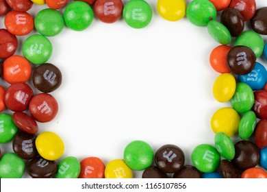 Selangor, Malaysia - August 14, 2018 : Image of colored mini m&m candies. M&M's is the flagship product of the Mars Wrigley Confectionery division of Mars, Incorporated.