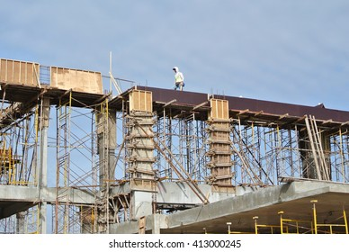 SELANGOR, MALAYSIA -AUGUST 2015: Timber beam formwork supported by row of scaffolding in construction site in Malaysia